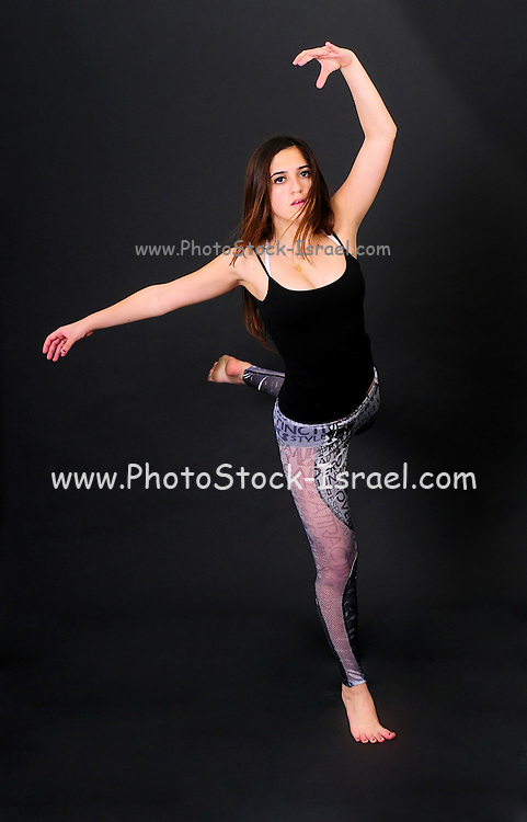 Young female teen of thirteen modern dancer On black Background