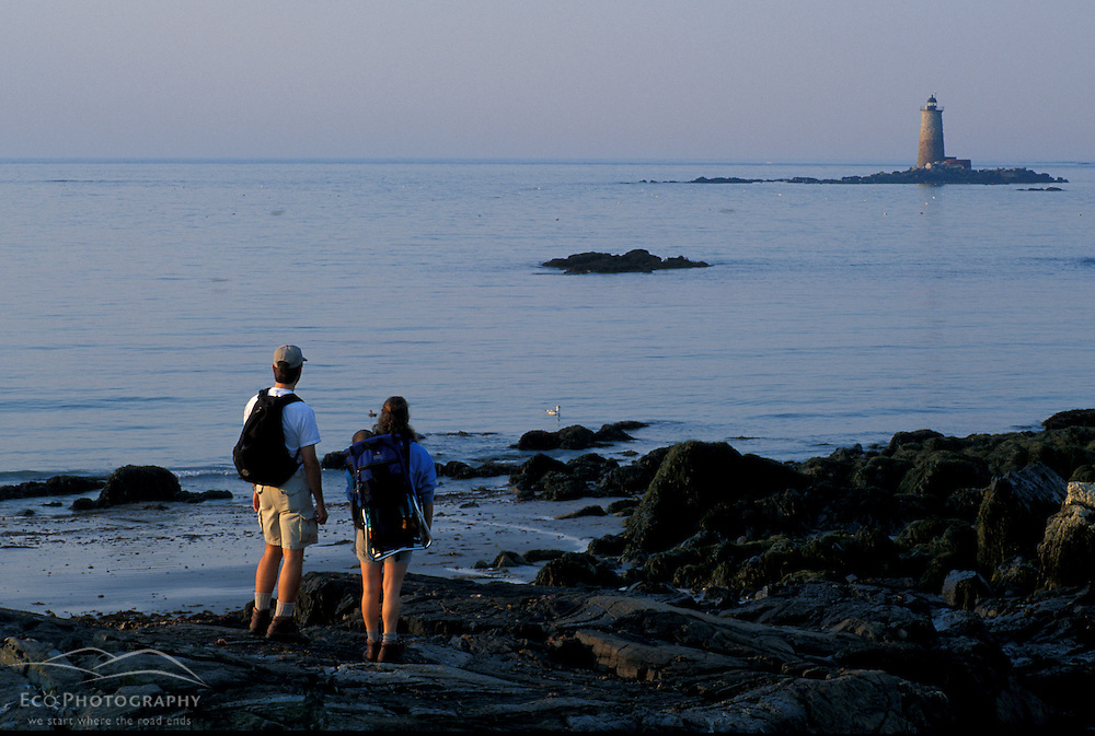 Kittery, ME. A family enjoys the coastal scenery at Fort Foster State Park.  Whaleback Light.