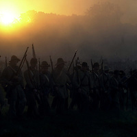 Confederate troops advance on Union positions during the sunrise battle on  Saturday during the weekend-long Battle of Perryville, a national Civil War  Reenactment, in Perryville, Ky., on 10/5/02. The sunrise battle depicts the  opening attack of Daniel Donelson's Confederate Brigade against the center of  the Union First Corps.