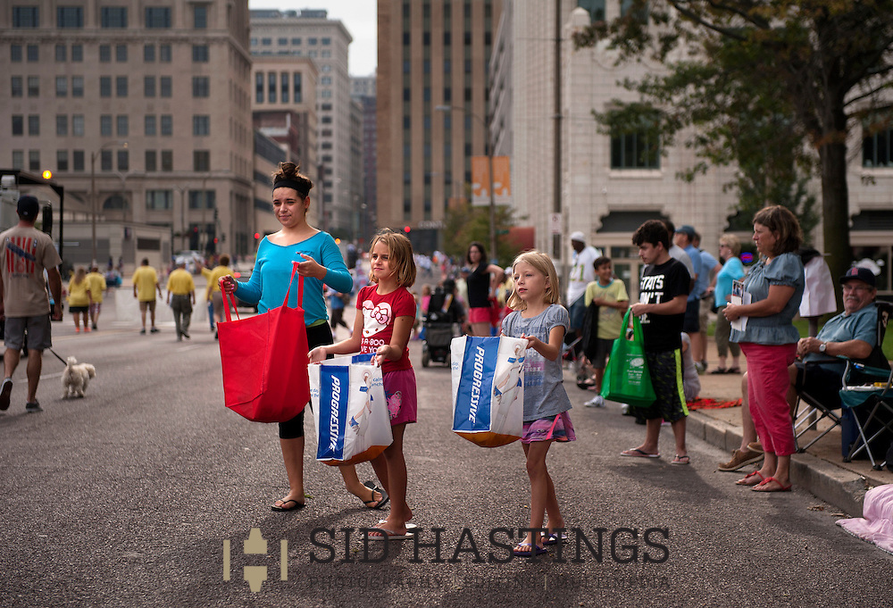 7 SEPT. 2015 -- ST. LOUIS -- Parade spectators Erin Dirie (left), 15, Nicole Bast, 7, and Katelyn Dirie, 8, wait in anticipation of thrown candy by parade participants during the 2015 Labor Day Parade in downtown St. Louis Monday, Sept. 7, 2015. The girls were at the parade with Sheila Dirie, their mother and aunt, of St. Peters, Mo. Photo © copyright 2015 Sid Hastings.