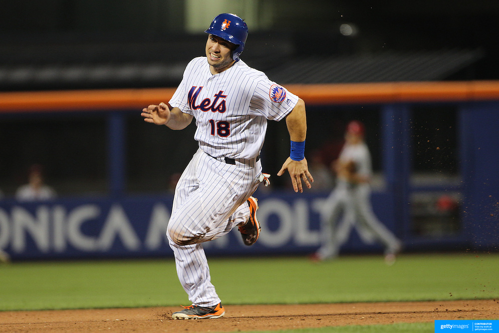 NEW YORK, NEW YORK - July 27: Travis d'Arnaud #18 of the New York Mets running to third base during the St. Louis Cardinals Vs New York Mets regular season MLB game at Citi Field on July 27, 2016 in New York City. (Photo by Tim Clayton/Corbis via Getty Images)