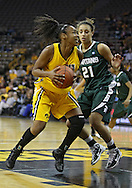 January 27 2010: Iowa guard Kachine Alexander (21) drives past Michigan St. guard Klarissa Bell (21) during the first half of an NCAA women's college basketball game at Carver-Hawkeye Arena in Iowa City, Iowa on January 27, 2010. Iowa defeated Michigan State 66-64.