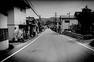 Main Street in the veritable ghost town of Kawauchi Village, which sits right on top of the 20 km (12.4 miles) nuclear no-entry zone line.  Less than two weeks ago, this half of the village was within the exclusion zone but the police check point has been moved back to the edge of the village.  It still sits within the 30 km (18.6 miles) voluntary evacuation zone where residents are encouraged to stay indoors and be ready for immediate evacuation if necessary.  Important crossroads between Koriyama in the main central valley and Iwaki a seaside harbor town, pass through this isolated mountain village.  Some villagers have begun to return but the village remains a ghost town.   Fukushima Prefecture, Japan.