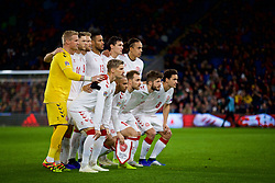 CARDIFF, WALES - Friday, November 16, 2018: Denmark players line-up for a team group photograph before the UEFA Nations League Group Stage League B Group 4 match between Wales and Denmark at the Cardiff City Stadium. Back row L-R: goalkeeper Kasper Schmeichel, Henrik Dalsgaard, Nicolai Jorgensen, Mathias Jorgensen, Andreas Christensen, Yussuf Yurary Poulsen. Front row L-R: Jens Stryger Larsen, Martin Braithwaite, captain Christian Eriksen, Lasse Schone, Thomas Delaney. (Pic by David Rawcliffe/Propaganda)