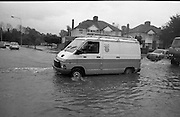 "Flooding at the Dodder..1986..26.08.1986..08.26.1986..28th August 1986..As a result of Hurricane Charly (Charlie) heavy overnight rainfall was the cause of severe flooding in the Donnybrook/Ballsbridge areas of Dublin. In a period of just 12 hours it was stated that 8 inches of rain had fallen. The Dodder,long regarded as a ""Flashy"" river, burst its banks and caused great hardship to families in the 300 or so homes which were flooded. Council workers and the Fire Brigades did their best to try and alleviate some of the problems by removing debris and pumping out some of the homes affected..Note: ""Flashy"" is a term given to a river which is prone to flooding as a result of heavy or sustained rainfall...Image of telecom workers heading out to effect repairs to systems damaged by the flood."