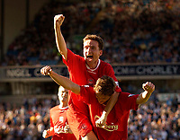 Photo. Jed Wee.<br /> Blackburn Rovers v Liverpool, FA Barclaycard Premiership, Ewood Park, Blackburn. 13/09/2003.<br /> Liverpool's Vladimir Smicer (C) rides on the shoulders of goalscorer Harry Kewell, as John Arne Riise looks to join the celebrations.