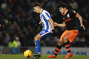Brighton & Hove Albion winger Anthony Knockaert shields the ball from Sheffield Wednesday forward Fernando Forestieri (45) during the EFL Sky Bet Championship match between Brighton and Hove Albion and Sheffield Wednesday at the American Express Community Stadium, Brighton and Hove, England on 20 January 2017. Photo by Bennett Dean.