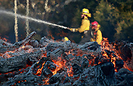 MALIBU, CA - NOV 11: Firefighters battle a blaze at the Salvation Army Camp on November 10, 2018 in Malibu, California. (Photo by Sandy Huffaker/Getty Images)