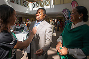 President Roderick J. McDavis and First Lady, Deborah McDavis interact with a Black Alumni Reunion coordinator confirming which decade President McDavis should be photographed with at the Black Alumni Reunion Cookout held at Grover Center Saturday afternoon.
