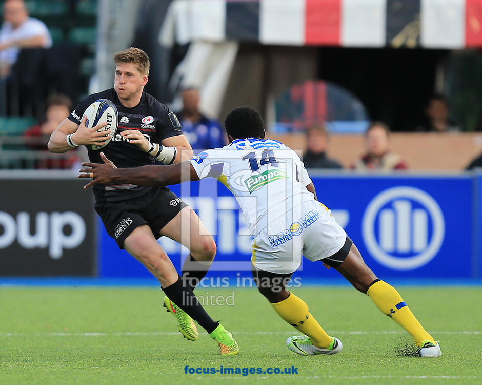 David Strettle of Saracens gets past Noa Nakaitaci of Clermont Auvergne during the European Rugby Champions Cup match at Allianz Park, London<br /> Picture by Michael Whitefoot/Focus Images Ltd 07969 898192<br /> 18/10/2014