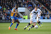 Sam Kelly of Port Vale FC under pressure from Jermaine Grandison of Shrewsbury Town during the Sky Bet League 1 match between Shrewsbury Town and Port Vale at Greenhous Meadow, Shrewsbury, England on 25 March 2016. Photo by Mike Sheridan.