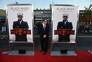 A police detail officer keeps his eye on the red carpet before a special screening of the film Black Mass at the Coolidge Corner Theater in Brookline, Sept. 15, 2015.