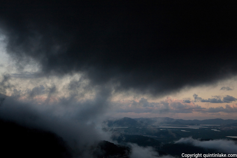 Dark clouds at dusk above Cubatão