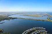 Nederland, Flevoland, Lelystad, 24-10-2013; eengezinswoningen en stadsvilla's in Lelystad-Haven, aan 't Bovenwater. Zicht op de Oostvaardersplassen.<br /> Family houses and town villas in Lelystad-Haven.<br /> luchtfoto (toeslag op standaard tarieven);<br /> aerial photo (additional fee required);<br /> copyright foto/photo Siebe Swart.