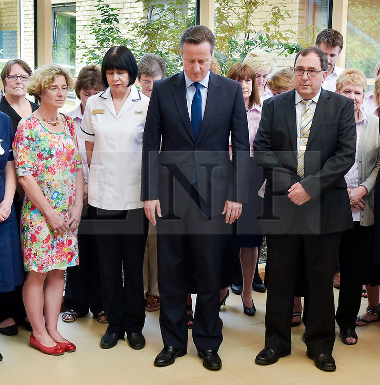 &copy; Licensed to London News Pictures. 03/07/2015. Chipping Norton, Oxfordshire. Prime Minister DAVID CAMERON observes the UK wide minute silence in memory of the victims of the Tunisia IS killing of tourists in the seaside town of Sousse. Mr Cameron is opening the new Health Centre at Chipping Norton.<br /> HEMSWORTH/LNP