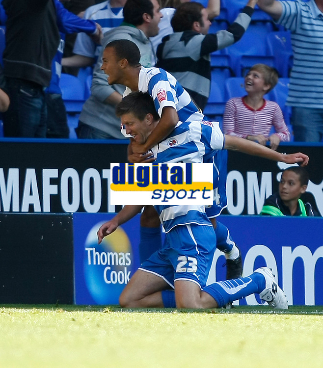 Photo: Steve Bond/Richard Lane Photography. Reading v Watford. Coca Cola Championship. 26/09/2009. Grzegorz Rasiak celebrates with Ryan Bertrand