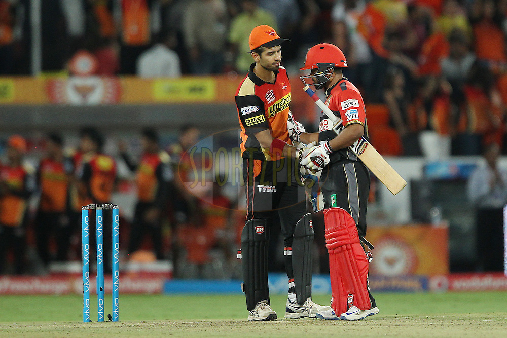 Naman Ojha of Sunrisers Hyderabad and Parveez Rasool of Royal Challengers Bangalore shake after the match during match 27 of the Vivo IPL 2016 (Indian Premier League ) between the Sunrisers Hyderabad and the Royal Challengers Bangalore held at the Rajiv Gandhi Intl. Cricket Stadium, Hyderabad on the 30th April 2016<br /> <br /> Photo by Ron Gaunt / IPL/ SPORTZPICS