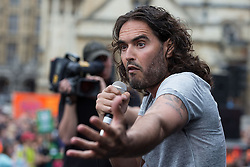 © Licensed to London News Pictures . 20/06/2015 . London , UK . RUSSELL BRAND speaks in Parliament Square . Tens of thousands of people march from the Bank of England to Parliament , to protest economic austerity in Britain . Photo credit: Joel Goodman/LNP