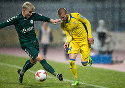 Zan Florjanc of Krka vs Veljko Batrovic  of Domzale during football match between NK Domzale and NK Krka in Semifinal of Slovenian Football Cup 2016/17, on April 4, 2017 in Sports park Domzale, Slovenia. Photo by Vid Ponikvar / Sportida