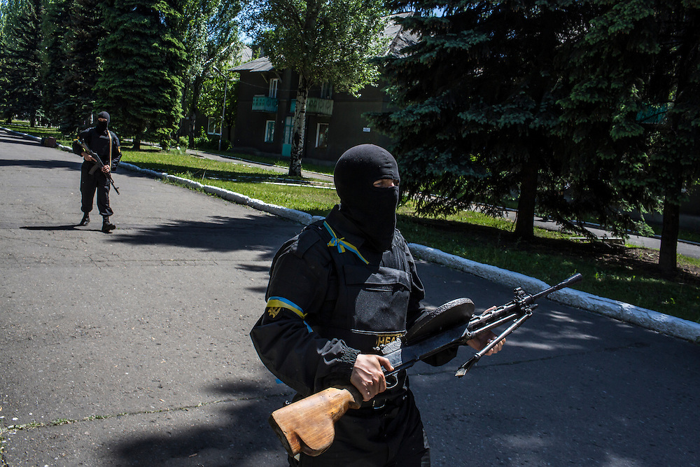 DOBROPILLYA, UKRAINE - MAY 21:  Members of the Donbass Battalion, a pro-Ukraine militia, arrive to meet with the local mayor to ensure the integrity of the upcoming presidential election on May 21, 2014 in Dobropillya, Ukraine. Days before presidential elections are scheduled, questions remain whether the eastern regions of Donetsk and Luhansk are stable enough to administer the vote. (Photo by Brendan Hoffman/Getty Images) *** Local Caption ***