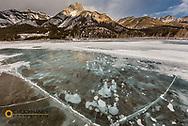 Mount Abrahamn and methane ice bubbles under clear ice on Abraham Lake near Nordegg, Alberta, Canada