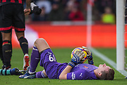 Bernd Leno (GK) (Arsenal) on the ground with the ball following a save during the Premier League match between Bournemouth and Arsenal at the Vitality Stadium, Bournemouth, England on 25 November 2018.