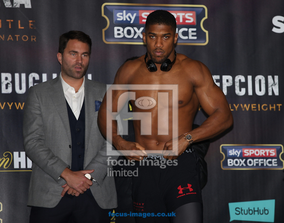Eddie Hearn (left) and Anthony Joshua (right) during the weigh in for the Joshua v Molina IBF Heavyweight title fight at Victoria Warehouse, Manchester<br /> Picture by James Wilson/Focus Images Ltd 07709 548263<br /> 09/12/2016