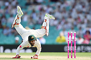Matthew Wade of Australia tries to stop the ball after being thrown by Nathan Lyon in an attempted run out during Day 2 of the Third Test match between Australia and Pakistan at the SCG in Sydney, Australia.