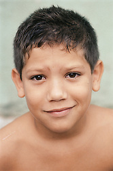 Portrait of young boy looking puzzled,