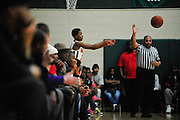 Fans make room for Morgan Park's Charlie Moore to inbound the ball since the stands leave no room on the sidelines at Morgan Park High School. Morgan Park is one of the top high school basketball programs in Illinois yet has one of the smallest gyms in the state with games selling out hours before tip off. Thursday, December 18th, 2014, in Chicago.