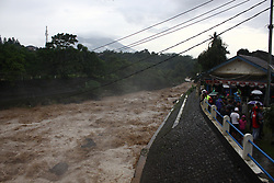 February 5, 2018 - Jakarta, West Java, Indonesia - The situation at Katulampa Dam with high water volume on Monday, January 5, 2018.. The high intensity of rain last few days, causing an increase in water volume at the Katulampa dam, which is a source of water flow in the river Ciliwung which empties to the north of Jakarta Capital City. The high volume of water in the Ciliwung River poses a threat to the people living on the riverbank, including the residents of Jakarta who live on the banks of this river. According to the Jakarta Regional Disaster Management Agency, water will arrive in Jakarta at least 8 hours after the dam door is opened. (Credit Image: © Aditya Irawan/NurPhoto via ZUMA Press)