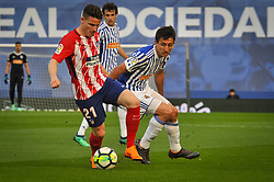 April 19, 2018 - San Sebastian, Spain - Kevin Gameiro of Atletico Madrid duels for the ball with Oyarzabal of Real Sociedad during the Spanish league football match between Real Sociedad and Atletico Madrid at the Anoeta Stadium on 19 April 2018 in San Sebastian, Spain  (Credit Image: © Jose Ignacio Unanue/NurPhoto via ZUMA Press)