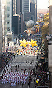 A marching band walks down 6th Avenue for the 89th annual Macy's Thanksgiving Day Parade as seen from above street level on Thursday, Nov. 26, 2015, in New York. (Photo by Ben Hider/Invision/AP)
