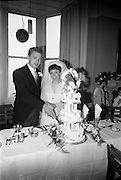 "16/09/1967<br /> 09/16/1967<br /> 16 September 1967<br /> Wedding of Mr Francis W. Moloney, 28 The Stiles Road, Clontarf and Ms Antoinette O'Carroll, ""Melrose"", Leinster Road, Rathmines at Our Lady of Refuge Church, Rathmines, with reception in Colamore Hotel, Coliemore Road, Dalkey. Image shows the Bride and Groom cutting the cake."