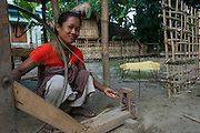 Spinning silk<br /> Mising Tribe (Mishing or Miri Tribe)<br /> Majuli Island, Brahmaputra River<br /> Largest river island in India<br /> Assam,  ne India