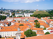 High-angle view across Vilnius from the Vilnius University belltower, in Senamiestyje/Old Town, Vilnius, Lithuania, withe Vilnius Clocktower, Vilnius Cathedral and Gediminas Tower/Boxto in the midground.