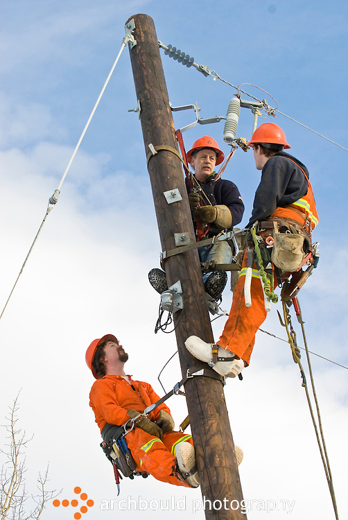 Linesmen working on power lines in Yukon.<br /> <br /> NOT IN YOUR BUDGET? Contact Cathie for a price specific to your project.
