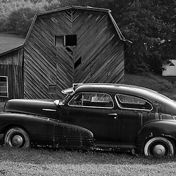 This car at one time might have raced around the mountain roads carrying moonshine but now it is just a large lawn ornament.
