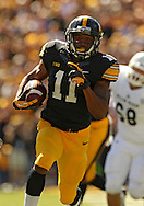 September 21 2013: Iowa Hawkeyes punt returner Kevonte Martin-Manley (11) runs back a punt 63 yards for a touchdown during the second quarter of the NCAA football game between the Western Michigan Broncos and the Iowa Hawkeyes at Kinnick Stadium in Iowa City, Iowa on September 21, 2013.