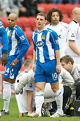 WIGAN, ENGLAND - Sunday, March 16, 2008: Wigan Athletic's Jason Koumas is shown the red card and sent off in the opening minutes of the Premiership match against Bolton Wanderers at the JJB Stadium. (Photo by David Rawcliffe/Propaganda)