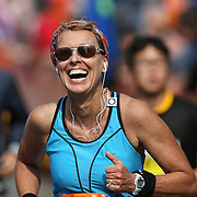 The Finish Line. Expressions of agony and ecstasy on the faces of athletes as Susan Hrabchak, Princeton, New Jersey, finishes the ING Hartford Marathon, Bushnell Park, Hartford. Connecticut. USA. Hartford, Connecticut, USA. 12th October 2013. Photo Tim Clayton