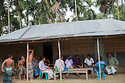At Borezerdanga village in one of the enclaves near the town of Debiganj a meeting is being held between village elders and men known as 'peace keepers' including Zoynul Hoque, 34, (purple shirt). Here to discuss the issue of an underage marriage, until a few weeks ago when the enclaves were disbanded the Bangladeshi police had no jurisdiction inside the enclaves so residents relied on peace keepers to sort out problems ranging from illegal logging to land disputes.<br /> <br /> On July 31st 2015 the enclaves that formed one of the world's most complicated borders were officially absorbed in to the countries that surrounded them in a land-mark land swap between India and Bangladesh. The people that lived in them will finally receive citizenship.<br /> <br /> Enclaves are small pockets of sovereign land completely surrounded by another sovereign nation. Approximately 160 enclaves, known as chitmahals, exist on either side of the India-Bangladesh border. For 68 years the 50,000 plus inhabitants of these enclaves have lived a difficult existence, stranded from their home nation and ignored by the country that surrounds them. <br /> <br /> In theory even leaving their enclaves is illegally crossing an international border and for decades it has been very difficult for them to receive even the most basic of rights whether education or health. Even the police have no jurisdiction in the enclaves leaving them essentially lawless.
