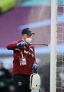 The goal posts are disinfected during the Premier League match at the London Stadium, London. Picture date: 20th June 2020. Picture credit should read: David Klein/Sportimage