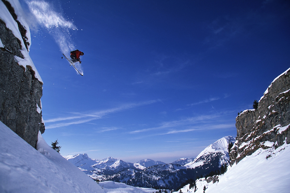 Sport. Male skier jumping off a mountain cliff, Chatel ski resort, France