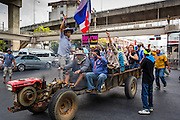19 FEBRUARY 2014 - BANGKOK, THAILAND: Anti-government protestors use a farm tractor to go to a protest in Bangkok. Anti-government protests organized by Suthep Thaugsuban and the People's Democratic Reform Committee have gridlocked parts of Bangkok since November.    PHOTO BY JACK KURTZ