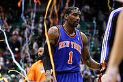 Knicks power forward Amar'e Stoudemire walks off the court after an NBA basketball game in Salt Lake City, Wednesday Jan. 12, 2011. (AP Photo/Colin E Braley)