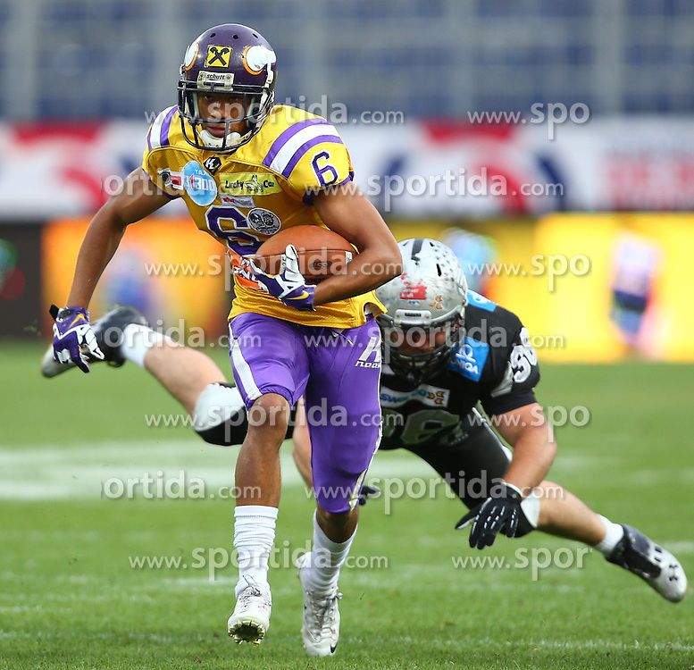 26.07.2014, NV Arena, St. Poelten, AUT, Austrian Bowl XXX, Raiffeisen Vikings Vienna vs Swarco Raiders Tirol, im Bild Laurinho Walch, (Raiffeisen Vikings Vienna, WR, #6) und Philipp Margreiter, (Swarco Raiders Tirol, DL, #36) // during the Austrian Bowl XXX between Raiffeisen Vikings Vienna and Swarco Raiders Tirol at the NV Arena, St. Poelten, Austria on 2014/07/26. EXPA Pictures © 2014, PhotoCredit: EXPA/ Thomas Haumer