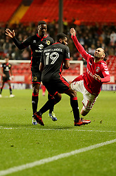 Charlton Athletics Ricky Holmes is fouled by  Milton Keynes Dons Ethan Ebanks-Landell during the Sky Bet League One match at The Valley, Charlton.