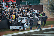 Fans cheer for Oakland Raiders quarterback Derek Carr (4) as he is carted off the field after injuring his leg against the Indianapolis Colts at Oakland Coliseum in Oakland, Calif., on December 24, 2016. (Stan Olszewski/Special to S.F. Examiner)