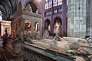 Transept with the gisants of Louis of France (d. 1260), Philip of France (d. 1235), 13th century, stone and pâte de verre, origine Abbey of Royaumont, displayed to Saint Denis in 1817; funerary monument of Louis XII and Anne of Brittany, funerary monument of Dagobert on the opposite side of the central nave, Abbey church of Saint Denis, Seine Saint Denis, France. Picture by Manuel Cohen